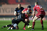 Leigh Halfpenny of the Scarlets is tackled by Semesa Rokoduguni of Bath Rugby. European Rugby Champions Cup match, between the Scarlets and Bath Rugby on October 20, 2017 at Parc y Scarlets in Llanelli, Wales. Photo by: Patrick Khachfe / Onside Images