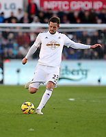 SWANSEA, WALES - FEBRUARY 21: Gylfi Sigurdsson of Swansea during the Barclays Premier League match between Swansea City and Manchester United at Liberty Stadium on February 21, 2015 in Swansea, Wales.