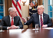 United States President Donald J. Trump gestures towards US Secretary of Defense James Mattis as he makes a statement to the media as he prepares to receive a briefing from senior military leaders in the Cabinet Room of the White House in Washington, DC on Tuesday, October 23, 2018.  The President took questions on the proposed space force, immigration, the caravan and Saudi actions in the killing of Jamal Khashoggi.<br /> Credit: Ron Sachs / Pool via CNP