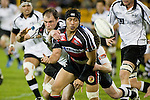 Tekori Luteru gets the onehanded pass away as he is tackled by Michael Johnson & Sam Giddens. Air New Zealand Cup rugby game between Counties Manukau Steelers & Hawkes Bay, played at Mt Smart Stadium on the 23rd of August 2007. Hawkes Bay won 38 - 14.