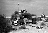 BNPS.co.uk (01202 558833)<br /> Pic: Pen&Sword/BNPS<br /> <br /> Anthony Barne's Marmon-Herrington armoured car camouflaged in the Western Desert, February 1942.<br /> <br /> Previously unseen photos of Winston Churchill both in the theatre of war and at leisure afterwards have come to light in a new book.<br /> <br /> One snap shows him addressing troops of his 4th Hussars regiment in Cairo, while he is seen in another at the door of an aircraft with a trademark cigar in his mouth. <br /> <br /> There is also a candid image of the wartime leader painting at Lake Como in September 1945 where he convalesced after losing to Clement Attlee in the general election.<br /> <br /> The photos belonged to Lieutenant Colonel Anthony Barne, who was commanding officer of the 4th Hussars.<br /> <br /> The photos, and Lt Col Barne's war diaries, are published for the first time in a new book, Churchill's Colonel, which has been edited by his grandson Charles Barne.
