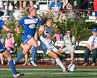 In a National Women's Soccer League Elite (NWSL) match, the Boston Breakers defeated the FC Kansas City, 1-0, at Dilboy Stadium on August 10, 2013.  FC Kansas City midfielder Kristie Mewis (19) passes the ball as Boston Breakers defender Carmelina Moscato (19) prepares to tackle her.
