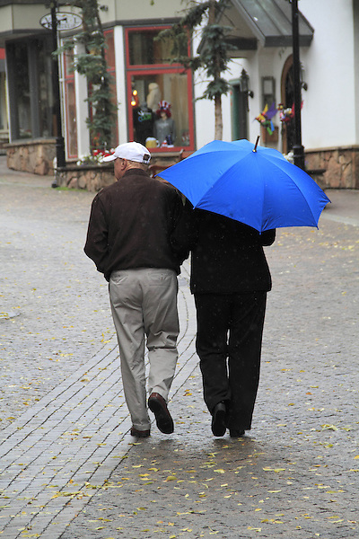 Older couple walking in Vail Village, Colorado,USA.