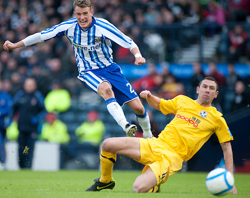 GLASGOW, SCOTLAND - JANUARY 28:  Kilmarnock's Dean Shiels second half shot as Ayr's John Robertson looks on during the Scottish Communities Cup Semi Final match between Ayr United and Kilmarnock at Hampden Park on January 28, 2012 in Glasgow, United Kingdom. (Photo by Rob Casey/Getty Images).