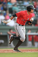 Designated hitter Antonio Rodriguez (14) of the Kannapolis Intimidators runs toward first in a game against the Greenville Drive on Wednesday, July 12, 2017, at Fluor Field at the West End in Greenville, South Carolina. Greenville won, 12-2. (Tom Priddy/Four Seam Images)