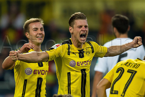 23.09.2016. Dortmund, Germany. German Bundesliga Football. Borussia Dortmund versus SC Freibrug.  Mario Goetze (BVB) and Lukasz Piszczek (BVB) celebrate their goal for 2:0