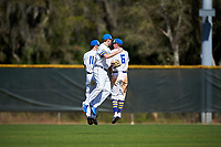 South Dakota State Jackrabbits Landon Badger (11), Colton Cox (12), and Logan Holtz (6) celebrate after a game against the FIU Panthers on February 23, 2019 at North Charlotte Regional Park in Port Charlotte, Florida.  South Dakota State defeated FIU 4-3.  (Mike Janes/Four Seam Images)