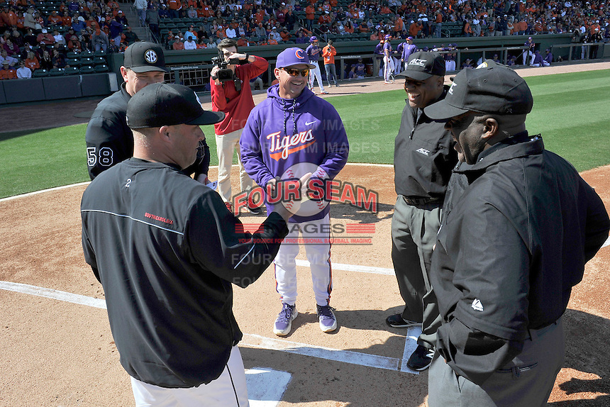 Head coaches Monte Lee and Chad Holbrook meet with umpires before the Reedy River Rivalry game on Saturday, March 4, 2017, at Fluor Field at the West End in Greenville, South Carolina. Clemson won, 8-7. (Tom Priddy/Four Seam Images)