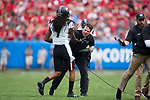 South Carolina Gamecocks head coach Will Muschamp congratulates JaMarcus King (7) after a defensive stop during first half action against the North Carolina State Wolfpack in the Belk College Kickoff at Bank of America Stadium on September 2, 2017 in Charlotte, North Carolina.  The Gamecocks defeated the Wolfpack 35-28.  (Brian Westerholt/Four Seam Images)