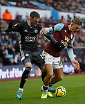 Jack Grealish of Aston Villa challenges James Maddison of Leicester City during the Premier League match at Villa Park, Birmingham. Picture date: 8th December 2019. Picture credit should read: Darren Staples/Sportimage
