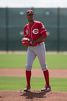 Cincinnati Reds starting pitcher Hunter Greene (21) prepares to deliver a pitch to the plate during a Minor league Spring Training game against the Los Angeles Angels at the Cincinnati Reds Training Complex on March 15, 2018 in Goodyear, Arizona. (Zachary Lucy/Four Seam Images)