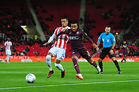Tom Ince of Stoke City vies for possession with Martin Olsson of Swansea City during the Sky Bet Championship match between Stoke City and Swansea City at the Bet 365 Stadium in Stoke on Trent, England, UK. Tuesday 18 September 2018