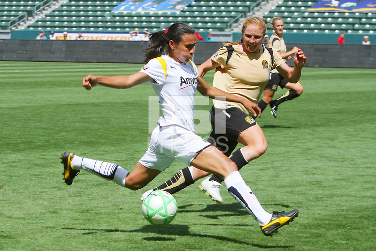 Marta #10 of the Los Angeles Sol runs over a loose ball against FC Gold Pride during their match at Home Depot Center on April 19, 2009 in Carson, California.