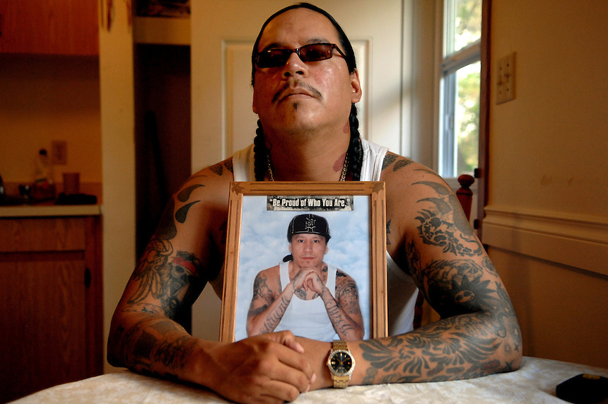 Richard Wolfe sits at his kitchen table in Fort Qu'Appelle, Saskatchewan, shortly after serving 15 years for attempted murder. Wolfe, along with his late brother Daniel (in picture), co-founded the Indian Posse street gang. Richard Wolfe died in a federal prison in Prince Albert, Saskatchewan in May 2016 at the age of 40.  MARK TAYLOR FOR THE GLOBE AND MAIL.