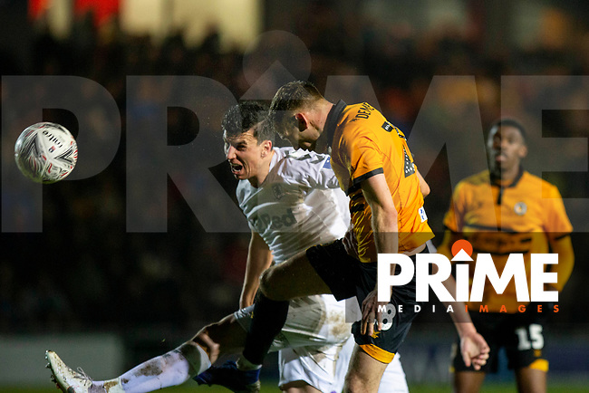 Mickey Demetriou of Newport County heads at goal under pressure from Daniel Ayala of Middlesbrough during the FA Cup 4th round replay match between Newport County and Middlesbrough at Rodney Parade, Newport, Wales on 5 February 2019. Photo by Mark  Hawkins / PRiME Media Images.