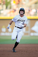 Adam Engel (7) of the Charlotte Knights hustles towards third base against the Durham Bulls at BB&T BallPark on May 16, 2017 in Charlotte, North Carolina.  The Knights defeated the Bulls 5-3. (Brian Westerholt/Four Seam Images)