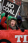A environmental activist cries for a clean energy future in front of the gates of the Capitol Coal Plant in Washington D.C. On March 2, 2009, thousands of protestors marched on the Capitol Coal Plant in Washington, D.C. The protestors were calling for clean renewable energy future. Two days before the planned protest, the US government announced that the plant would be converted to Natural Gas. Organizers cited this news as a partial, but incomplete victory - as Natural Gas is still a fossil fuel - and vowed to take on coal plants across the country.  (©Robert vanWaarden)