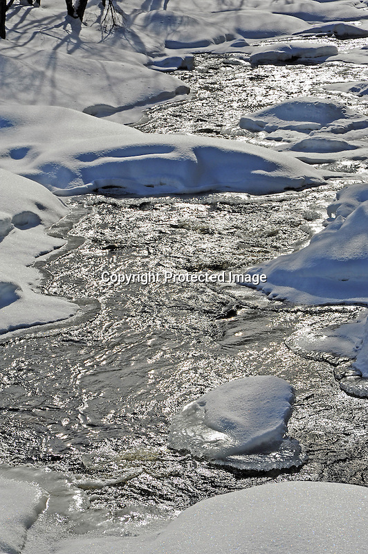 Snow Covered Rocks and Boulders in the Ashuelot River in New Hampshire