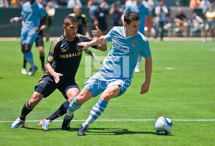 CARSON, CA – July 24, 2011: Sean Franklin (5) of LA Galaxy and Gareth Barry (18) of Manchester City during the match between LA Galaxy and Manchester City FC at the Home Depot Center in Carson, California. Final score Manchester City FC 1 and LA Galaxy 1. Manchester City wins shoot out 7, LA Galaxy 6.