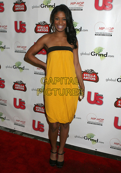QUI.Russell Simmons and US Magazine host 2009 Grammy Awards Post Party at a Private Residence, Beverly Hills, California, USA..February 8th, 2009.full length yellow strapless dress black trim hand on hip .CAP/ADM/MJ.©Michael Jade/AdMedia/Capital Pictures.