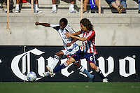 New England Revolution midfielder Sainey Nyassi (31) attempts to move past Chivas midfielder Francisco Mendoza (6). The Chivas USA and New England Revolution played to 1-1 draw during a early round match of the 2008 SuperLiga at Cal State Fullerton Titan stadium in Fullerton, California on Sunday July 20, 2008.