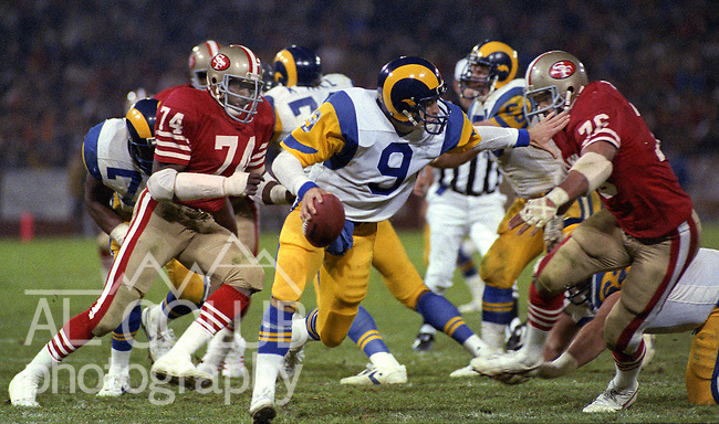 San Francisco 49ers vs. Los Angles Rams at Candlestick Park Monday, December 9, 1985..Rams beat the 49ers 27-20.Los Angles Rams Quarterback Jeff Kemp (9) hold off San Francisco 49ers Defensive End Dwaine Board (76) while San Francisco 49ers Defensive End Fred Dean (74) moves closer...