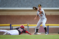West Virginia Black Bears first baseman Chris Harvey (10) catches a pick off attempt throw as Rony Cabrera (26) dives back to first during a game against the Batavia Muckdogs on June 28, 2016 at Dwyer Stadium in Batavia, New York.  Batavia defeated West Virginia 3-1.  (Mike Janes/Four Seam Images)