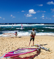 Windsurfers wait in turn to go out at Ho'okipa Beach, Maui. (NOTE: the man in foreground model released, the others are not model released.)