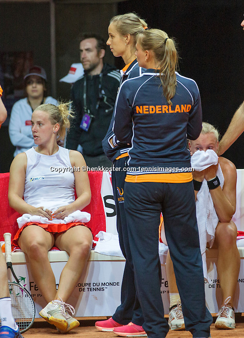 Arena Loire,  Trélazé,  France, 16 April, 2016, Semifinal FedCup, France-Netherlands, Double  Hogenkamp  (L) and Bertens (NED) losing in the third set of the fifth match and they are comforted for their los by their team members Rus and Burger<br /> Photo: Henk Koster/Tennisimages