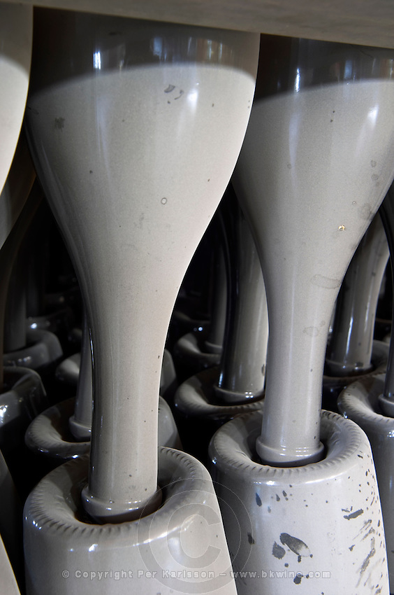 Dusty bottles of cava sparkling wine stacked on their heads. Albet i Noya. Bottles stored in the cellar. Penedes Catalonia Spain