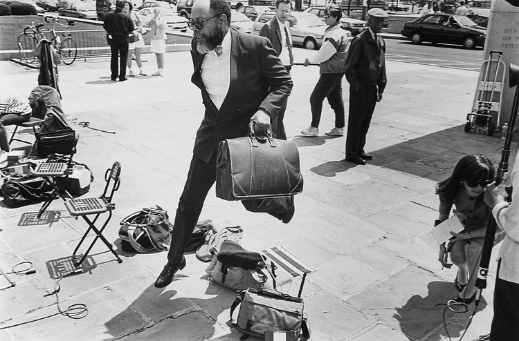 Rep. Craig Washington, D-Tex., leaps over press bags to enter court on May 04, 1992. (Photo by Laura Patterson/CQ Roll Call)