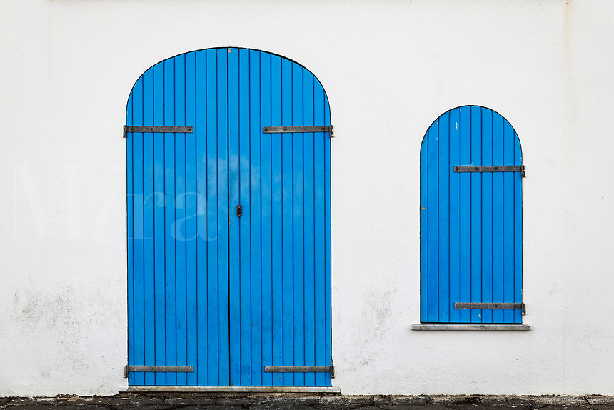 Blue door and shuttered window, Alghero, Sardinia, Italy.