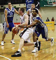 Saints import Mike Efevberha (right) fouls Heat guard Daniel Munday during the National Basketball League match Wellington Saints and Harbour Heat at TSB Bank Arena, Wellington, New Zealand on Saturday 13 June 2009. Photo: Dave Lintott / lintottphoto.co.nz