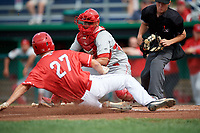 Auburn Doubledays catcher Wilmer Perez (45) reaches out to tag Davis Bradshaw (27) as he slides home as home plate umpire Roberto Pattison looks on during a game against the Batavia Muckdogs on September 2, 2018 at Dwyer Stadium in Batavia, New York.  Batavia defeated Auburn 5-4.  (Mike Janes/Four Seam Images)