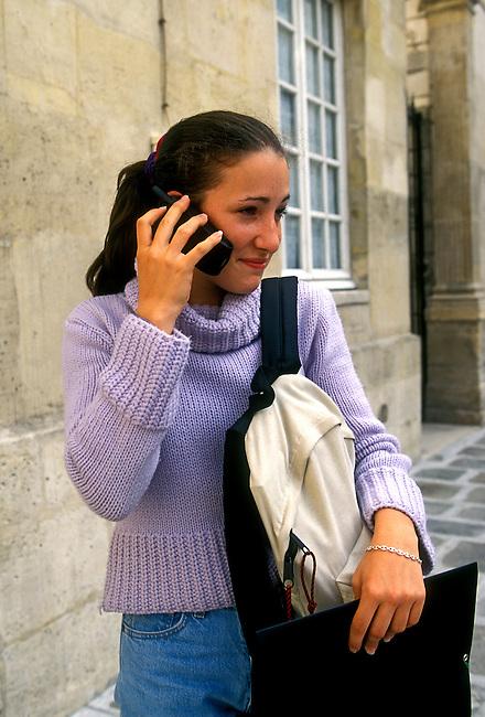 People, girl, student talking on cellular phone, city of Paris, Ile de France region, France, Europe.