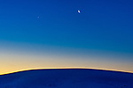 Dawn with Venus and waning crescent moon at White Sands National Monument in New Mexico.