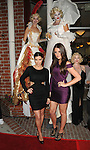 Kim Kardashian & Khloe Kardashian  at The Famous Cupcakes Beverly Hills Grand Opening hosted by The Kardashian Family in Beverly Hills, California on October 07,2009                                                                   Copyright 2009 DVS / RockinExposures
