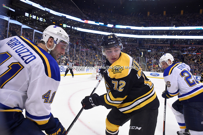Tuesday, December 22, 2015: Boston Bruins center Frank Vatrano (72) and St. Louis Blues defenseman Robert Bortuzzo (41) in game action during the National Hockey League game between the St. Louis Blues and the Boston Bruins held at TD Garden, in Boston, Massachusetts. The blues beat the Bruins 2-0 in regulation time. Eric Canha/CSM