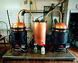 SWITZERLAND, Couvet, copper vats used to produce Absinthe at the Artemisia Distillerie, Jura Region