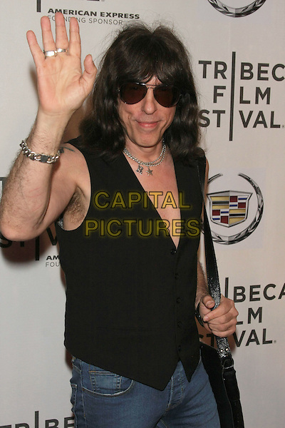 "MARKY RAMONE .attending the 10th Anniversary Edition of the Tribeca Film Festival - World Premiere of the documentary ""God Bless Ozzy Osbourne"" at the Tribeca Performing Arts Center, New York, NY, USA, April 24th 2011..half length black waistcoat sunglasses hand jeans waving .CAP/LNC/TOM.©LNC/Capital Pictures."