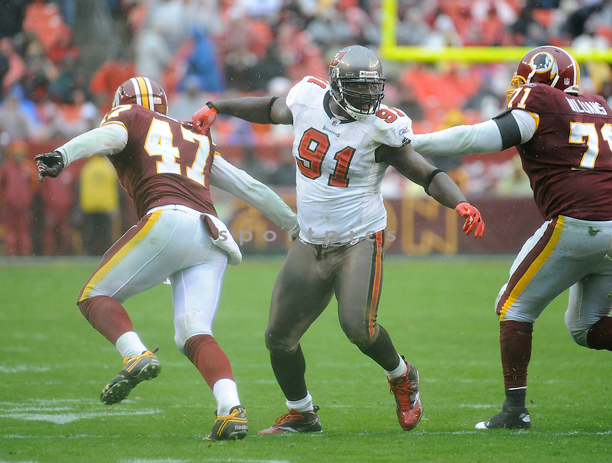 STYLEZ G WHITE, of the Tampa Bay Buccaneers in action durIng the Bucs game against the Washington Redskins at FedEx Field in Landover, MD on December 12, 2010...Bucs beat the Redskins 17-16