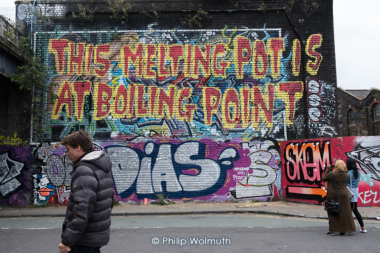 THIS MELTING POT IS AT BOILING POINT.  Street art wall-painting, Shoreditch, London.