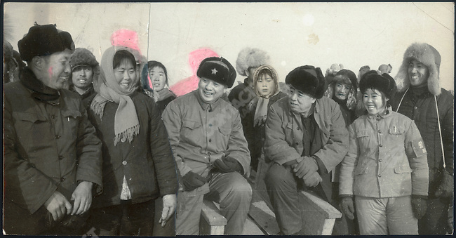 """Vintage montage picture was published in the Heilongjiang Daily in December 1974 as part of a photo essay devoted to an irrigation project in Shuangcheng County. The site was officially inspected by Liu Guangtao (center, with star on hat), first secretary of the Provincial Party Committee and director of the Provincial Revolutionary Committee, and his deputy Yang Yichen (to his left). Li Zhensheng was not able to include in a single frame the two dignitaries greeting local Party leaders. The editors asked him to make one image from two prints by cutting and pasting them together. Moving scissors around and additional retouching made the scene seem more """"real"""" and upbeat."""