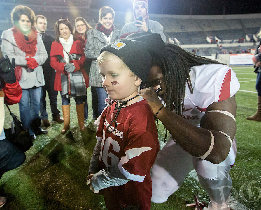 NWA Democrat-Gazette/JASON IVESTER <br /> Arkansas vs Kansas St, Liberty Bowl<br /> Arkansas running back Alex Collins (3) autographs a jersey for Gatlin Davis, 4, of Jonesboro following the game on Saturday, Jan. 2, 2016, at the Liberty Bowl in Memphis, Tenn.