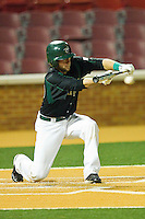 Ross Steedley #40 of the Charlotte 49ers drops down a bunt against the Wake Forest Demon Deacons at Gene Hooks Field on March 22, 2011 in Winston-Salem, North Carolina.   Photo by Brian Westerholt / Four Seam Images