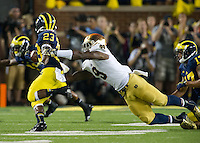 Linebacker Jaylon Smith (9) attempts to tackle Michigan Wolverines wide receiver Dennis Norfleet (23) in the first quarter.