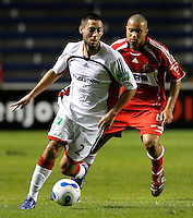 New England Revolution midfielder Clint Dempsey (2) dribbles in front of Chicago Fire defender Leonard Griffin (4).  The Chicago Fire defeated the New England Revolution 2-1 in the quarterfinals of the U.S. Open Cup at Toyota Park in Bridgeview, IL on August 23, 2006...