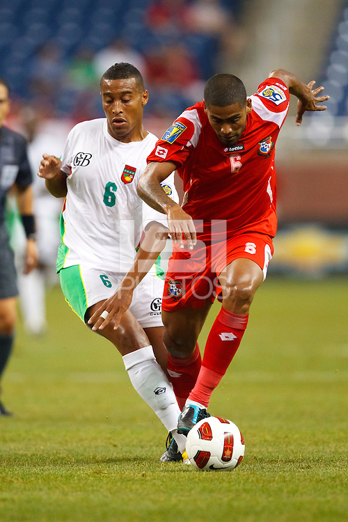 7 June 2011: Guadeloupe midfielder David Fleurival (6) and Panama midfielder Gabriel Gómez (6) go for the ball during the CONCACAF soccer match between Panama and Guadeloupe at Ford Field Detroit, Michigan.