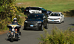WOLCOTT, CT-101117JS01-- Lily, a 17-year old retired state police narcotics dog, is escorted by the Walcott Police Department,  to the Wolcott Veterinary Clinic in Wolcott on Thursday to be put to sleep due to health issues. <br /> Jim Shannon Republican-American