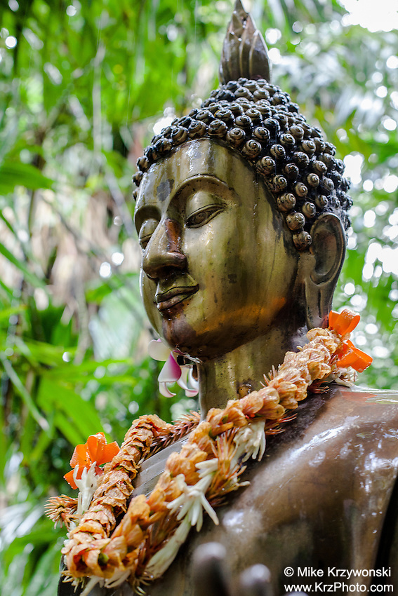 Buddha statue w/ leis at Harold L. Lyon Arboretum and Botanical Garden,Honolulu, Oahu, Hawaii